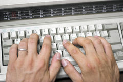 Typing. Hands on typewriter Stock Photo