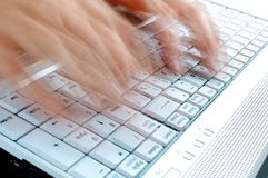 Typing. Fast Typing on Laptop Keyboard Stock Images