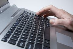 Typing. Notebook close-up photo, male hands typing on a laptop Royalty Free Stock Photography