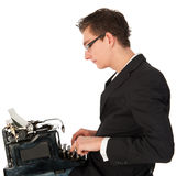 Typing on the black typewriter Stock Images