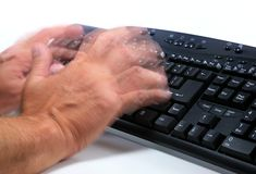 Typing Blur. Hand Motion while typing on a keyboard Royalty Free Stock Photography