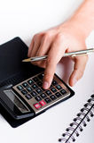 Typing on calculator Stock Image