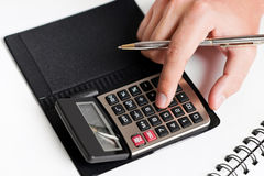 Typing on calculator Royalty Free Stock Image