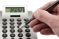 Typing on calculator Royalty Free Stock Photos