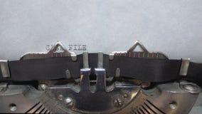 Typing text at the typewrite. Typing CASE FILE at the typewriter stock footage