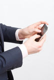 Typing on cell phone royalty free stock photo