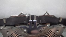 Typing text at the typewrite. Typing CHAPTER ONE at the typewriter stock video footage