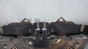 Typing text at the typewrite. Typing CHAPTER ONE at the typewriter stock footage
