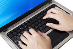 Typing close up. Closeup of hands typing on ultrabook laptop computer Stock Photo