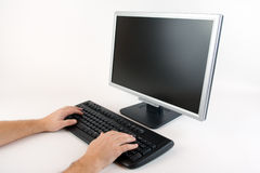 Typing on a computer Royalty Free Stock Photo