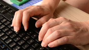 Typing on computer Stock Image