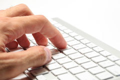 Typing on a computer keyboard Stock Photos