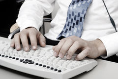 Typing on computer keyboard Royalty Free Stock Photo