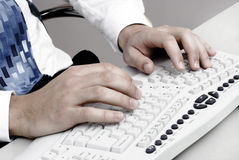 Typing on computer keyboard Royalty Free Stock Image
