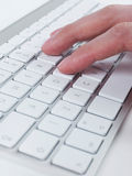 Typing on computer keyboard Royalty Free Stock Photos