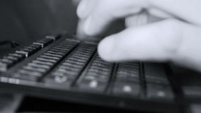 Typing on a computer keyboard. Man hands typing on a computer keyboard stock footage