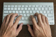 Typing a computer keyboard Royalty Free Stock Images