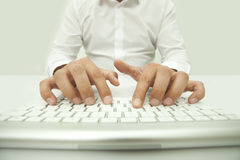 Typing on the Computer Keyboard Royalty Free Stock Images