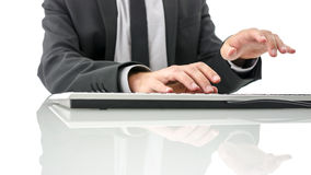 Typing on computer keyboard on white office desk Royalty Free Stock Photo