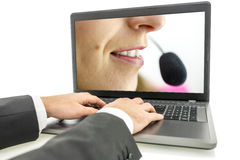 Typing customer complaint Royalty Free Stock Image