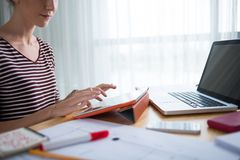 Typing on digital tablet. Cropped image of woman typing on digital tablet stock photography