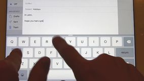 Typing email on the touch screen stock video footage