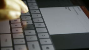 Typing an email on a touchscreen keyboard,Virtual Keyboard,Shallow depth of field. stock video