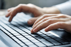 Typing female hands Royalty Free Stock Photography