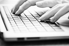 Typing female hands on keyboard Royalty Free Stock Photos