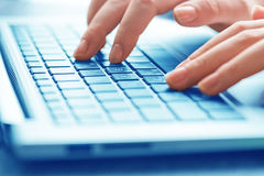 Typing female hands on keyboard Royalty Free Stock Photography