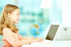 Typing girl Stock Image