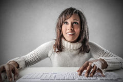 Typing girl Royalty Free Stock Photos