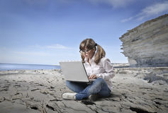 Typing girl. A nice girl is typing royalty free stock photos