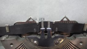 Typing text at the typewrite. Typing GOOD BYE at the typewriter stock video