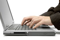 Typing on a Grey Laptop. Royalty Free Stock Photos