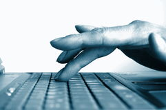 Typing hands on keyboard Stock Photo