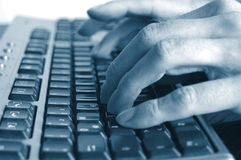 Typing hands on keyboard Royalty Free Stock Image