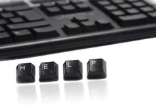Typing help. A computer keyboard and the letters spelling out help Royalty Free Stock Image