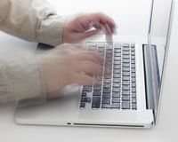 Typing on keyboard Royalty Free Stock Photography