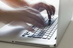 Typing on keyboard. Two hands fast typing on the laptop keyboard Stock Images
