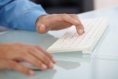 Typing on keyboard Royalty Free Stock Image