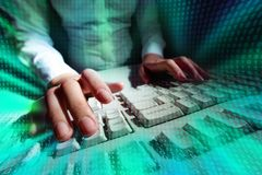 Typing at keyboard. Picture of a person typing at a keyboard with matrix effect put over Royalty Free Stock Photography