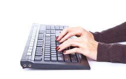Typing on keyboard. Isolated on whitw background stock photo