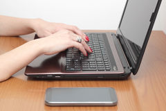 Typing on the keyboard Royalty Free Stock Image