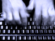 Typing On Keyboard. Business man typing on a computer keyboard stock photography