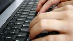 Typing on keyboard. Typing on black laptop keyboard stock footage
