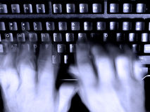 Typing On Keyboard blurry Hands Royalty Free Stock Images