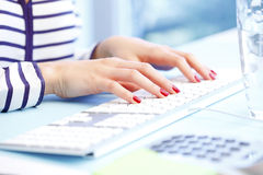 Typing on keyboard Stock Images