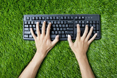 Typing keyboard on grass Royalty Free Stock Photography