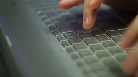 Typing on Keyboard. Man Typing On Laptop Keyboard Shallow DOF Dolly stock footage